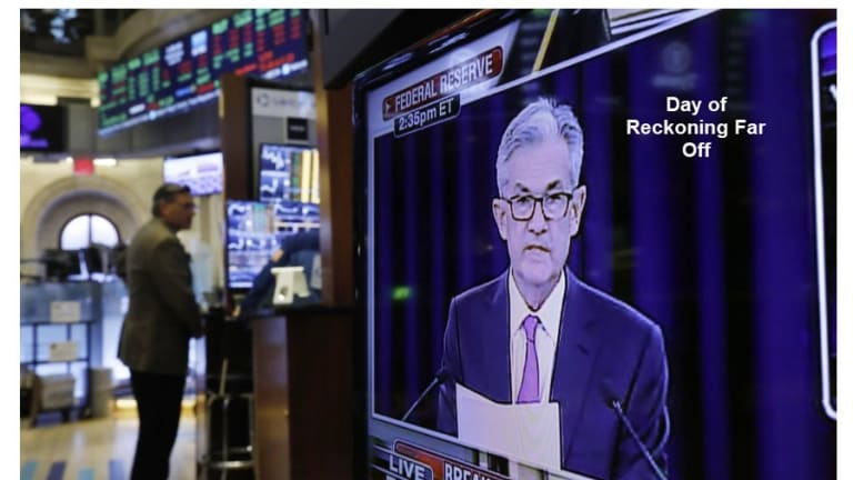 """Powell Says """"Day of Reckoning"""" Far Off"""