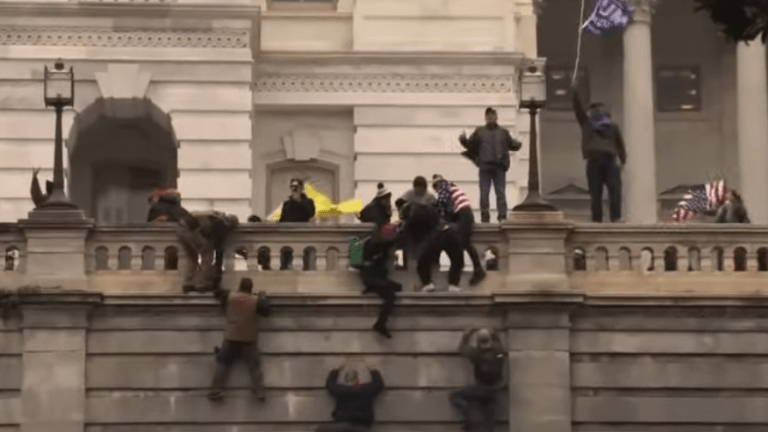 Impeachment Trial Begins With a Video of an Angry Mob Storming the Capitol