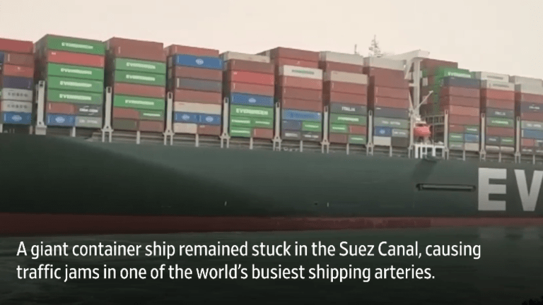 Over 100 Ships Backed Up as Vessel Stuck in Suez Canal Sideways