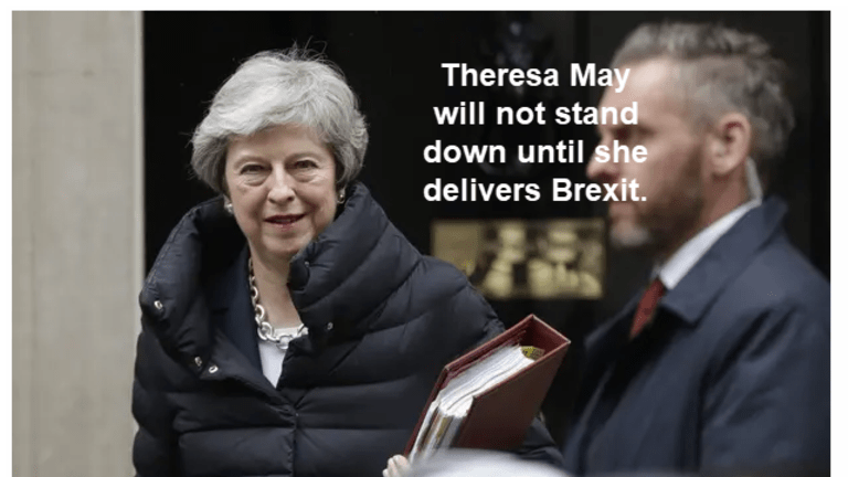 Theresa May Will Not Stand Down: Will the Men in Gray Suits Forcibly Remove Her?